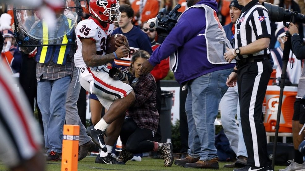 Photographer releases statement after hit during Georgia-Auburn game